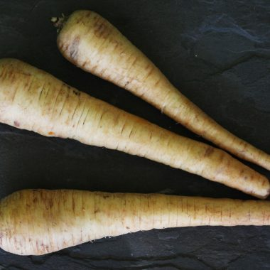 A photo of three parsnips